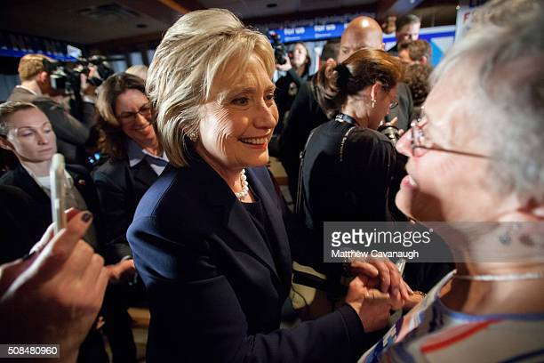 Democratic presidential candidate former Secretary of State Hillary Clinton greets supporters at a debate watching party on February 4 2016 in Durham...