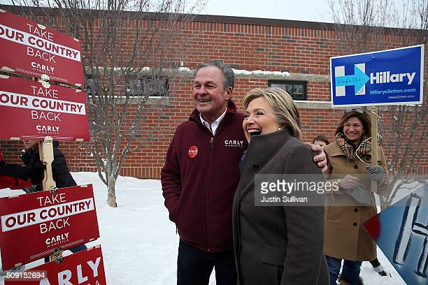 Democratic presidential candidate former Secretary of State Hillary Clinton poses for a picture with Frank Fiorina husband of republican presidential...
