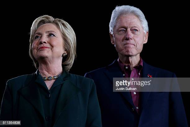 Democratic presidential candidate former Secretary of State Hillary Clinton and her husband former US president Bill Clinton look on during a Get Out...