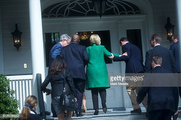 Democratic Presidential candidate former Secretary of State Hillary Clinton slips as she walks up the stairs into the nonprofit SC Strong a 2 year...