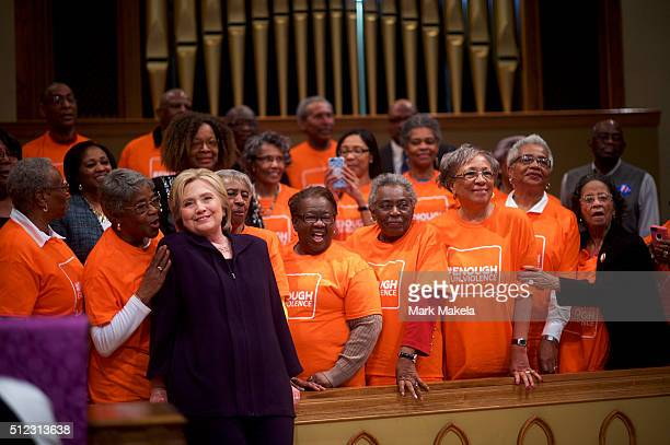 Democratic Presidential candidate former Secretary of State Hillary Clinton poses for a photo with members of the Brady Campaign to Prevent Gun...