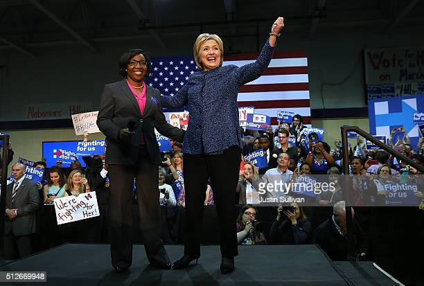 Democratic presidential candidate former Secretary of State Hillary Clinton greets supporters from on stage during a Get Out The Vote at Miles...