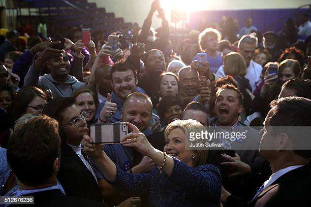 Democratic presidential candidate former Secretary of State Hillary Clinton takes a selfie with a supporter during a Get Out The Vote at Miles...