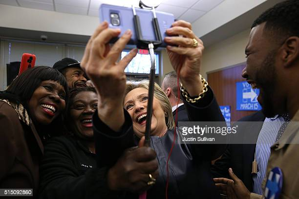 Democratic presidential candidate former Secretary of State Hillary Clinton takes a selfie with supporters during a canvass kickoff event at the...
