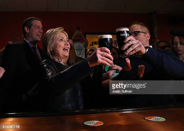 Democratic presidential candidate former Secretary of State Hillary Clinton toasts a patron as she has a pint of Guinness beer at O'Donold's Irish...