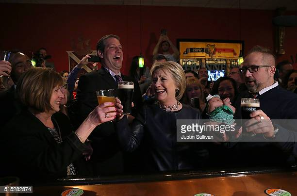 Democratic presidential candidate former Secretary of State Hillary Clinton toasts with patrons as she has a pint of Guinness beer at O'Donold's...
