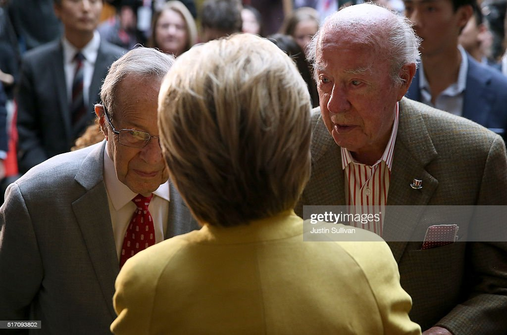 Democratic presidential candidate former Secretary of State Hillary Clinton talks with former Secretary of Defense William Perry (L) and former Secretary of State George Shultz (R) after delivering a counterterrorism address at Stanford University on March 23, 2016 in Stanford, California. A day after terror attacks left dozens people dead in Brussels, Hillary Clinton delivered a counterterrorism speech.