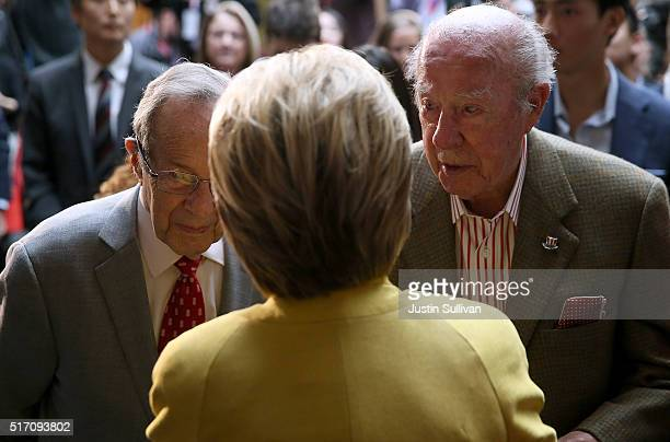 Democratic presidential candidate former Secretary of State Hillary Clinton talks with former Secretary of Defense William Perry and former Secretary...