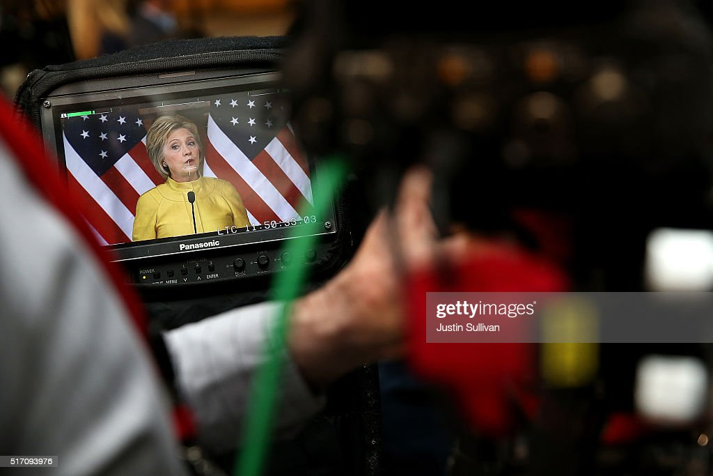 Democratic presidential candidate former Secretary of State Hillary Clinton is seen on a monitor as she delivers a counterterrorism address at Stanford University on March 23, 2016 in Stanford, California. A day after terror attacks left dozens people dead in Brussels, Hillary Clinton delivered a counterterroism speech.