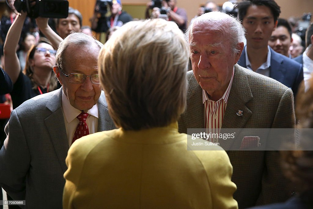 Democratic presidential candidate former Secretary of State Hillary Clinton talks with former Secretary of Defense William Perry (L) and former Secretary of State George Shultz (R) after delivering a counterterrorism address at Stanford University on March 23, 2016 in Stanford, California. A day after terror attacks left dozens people dead in Brussels, Hillary Clinton delivered a counterterroism speech.