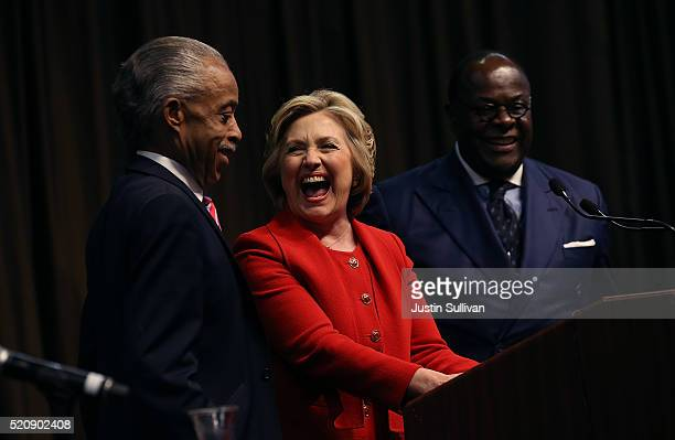 Democratic presidential candidate former Secretary of State Hillary Clinton laughs with Rev Al Sharpton during the National Action Network's 25th...