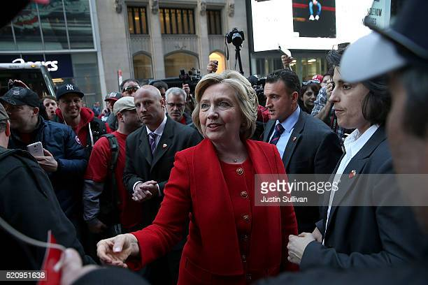 Democratic presidential candidate former Secretary of State Hillary Clinton greets picketing Verizon workers outside of a Verizon store on April 13...