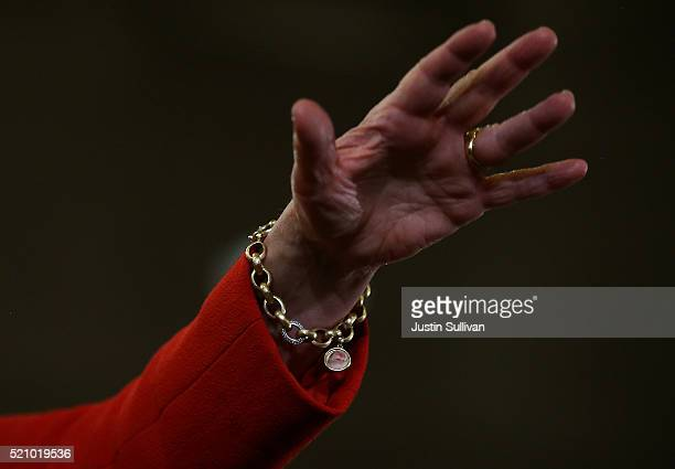 Democratic presidential candidate former Secretary of State Hillary Clinton wears a charm bracelet with an image of her granddaughter Charlotte...
