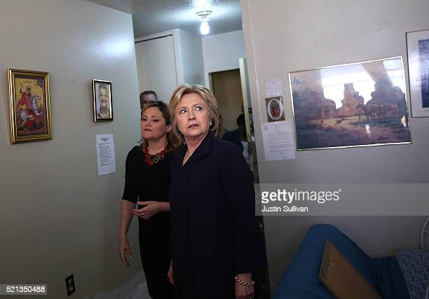 Democratic presidential candidate former Secretary of State Hillary Clinton tours a public housing unit that is undergoing repairs at the Corsi House...