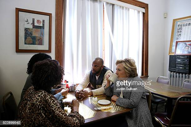 Democratic presidential candidate former Secretary of State Hillary Clinton has coffee with patrons at Cozy Spot restaurant on April 21, 2016 in...