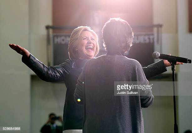 Democratic presidential candidate former Secretary of State Hillary Clinton greets US Sen Barbara Boxer during a campaign rally on May 6 2016 in...