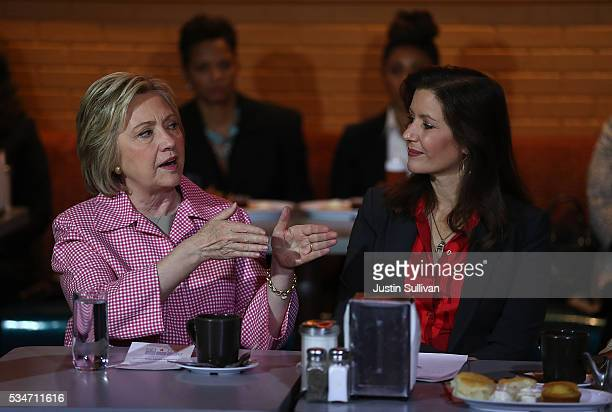Democratic presidential candidate former Secretary of State Hillary Clinton talks with Oakland mayor Libby Schaaf during a roundtable discussion at...