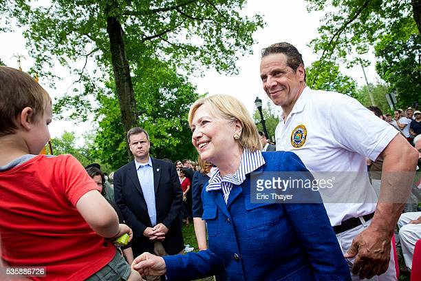 Democratic presidential candidate former Secretary of State Hillary Clinton and New York Governor Andrew M Cuomo greet parade goers during the...