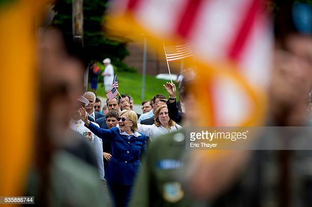Democratic presidential candidate former Secretary of State Hillary Clinton walks in the Memorial Day parade May 30 2016 in Chappaqua New York