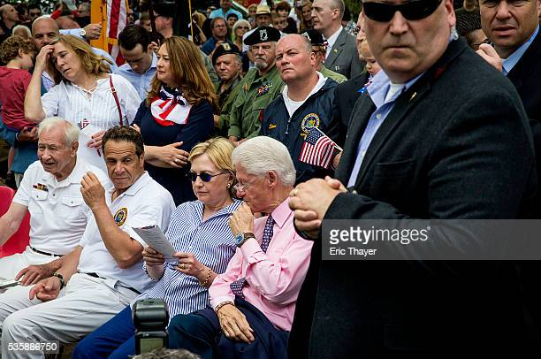 Democratic presidential candidate former Secretary of State Hillary Clinton former President Bill Clinton and New York Governor Andrew M Cuomo attend...