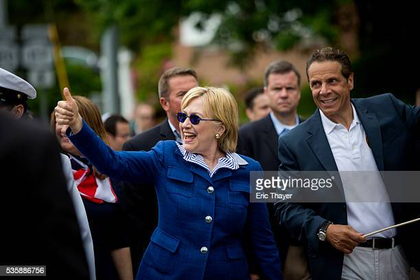 Democratic presidential candidate former Secretary of State Hillary Clinton and New York Governor Andrew M Cuomo walk in the Memorial Day parade May...