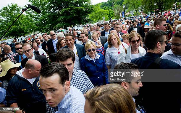 Democratic presidential candidate former Secretary of State Hillary Clinton former President Bill Clinton and New York Governor Andrew M Cuomo walk...