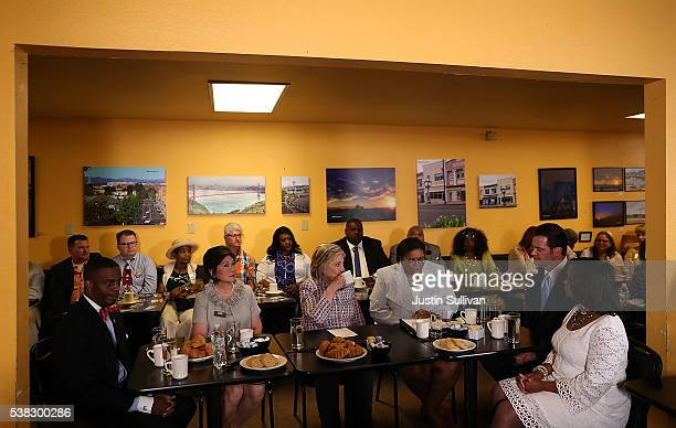 Democratic presidential candidate former Secretary of State Hillary Clinton drinks coffee as she participates in a conversation with community...