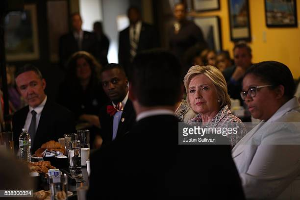 Democratic presidential candidate former Secretary of State Hillary Clinton looks on during a conversation with community leaders on June 5 2016 in...