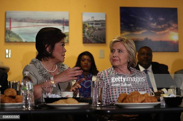 Democratic presidential candidate former Secretary of State Hillary Clinton looks on as Vallejo vice mayor Rozzana VerderAliga speaks during a...