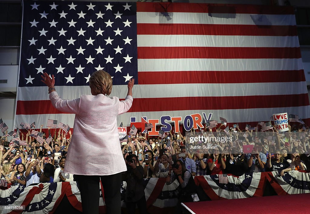 Democratic presidential candidate former Secretary of State Hillary Clinton greets supporters during a primary night event on June 7, 2016 in Brooklyn, New York. Hillary Clinton surpassed the number of delegates needed to become the democratic nominee over rival Bernie Sanders with a win in the New Jersey presidential primary