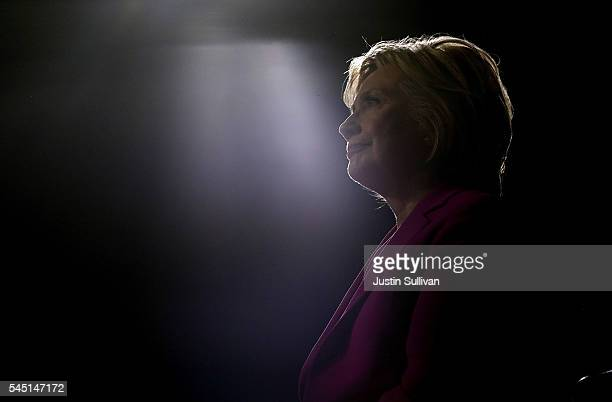 Democratic presidential candidate former Secretary of State Hillary Clinton looks on as US president Barack Obama speaks during a campaign rally with...
