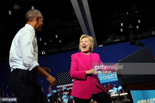 Democratic presidential candidate former Secretary of State Hillary Clinton and US president Barack Obama share a laugh during a campaign rally on...