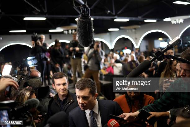 Democratic presidential candidate former South Bend, Indiana Mayor Pete Buttigieg answers questions from the media after speaking at a Get Out The...