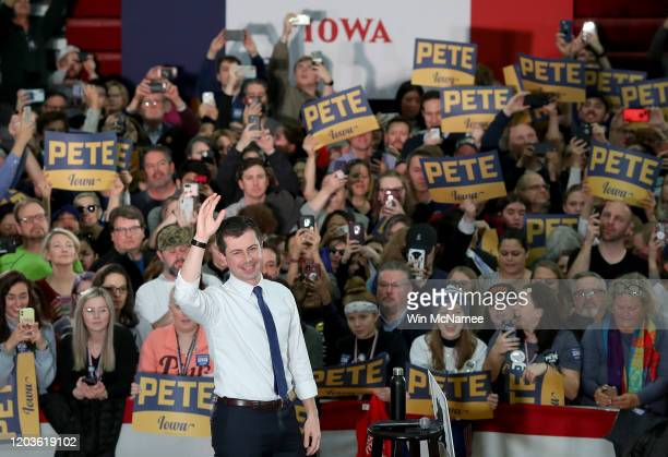 Democratic presidential candidate former South Bend, Indiana Mayor Pete Buttigieg arrives on stage at Lincoln High School during a Get Out The Caucus...