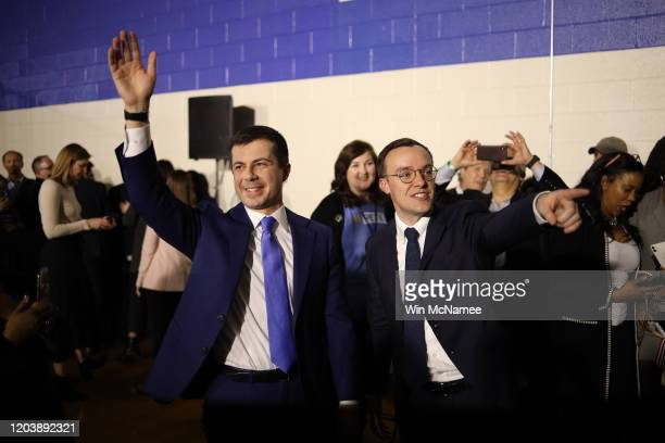 Democratic presidential candidate former South Bend Indiana Mayor Pete Buttigieg and his husband Chasten wave to supporters after Buttigieg spoke at...
