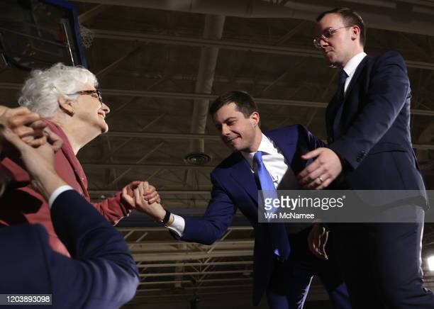 Democratic presidential candidate former South Bend Indiana Mayor Pete Buttigieg and his husband Chasten help Buttigieg's mother Anne Montgomery on...