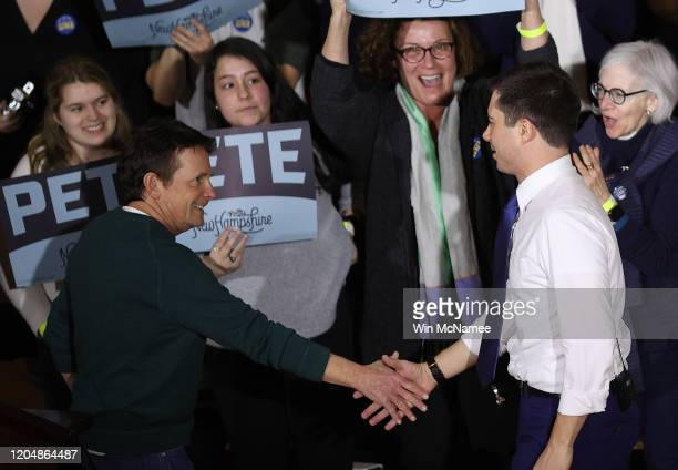 Democratic presidential candidate former South Bend Indiana Mayor Pete Buttigieg greets actor Michael J Fox after Fox introduced the candidate at a...