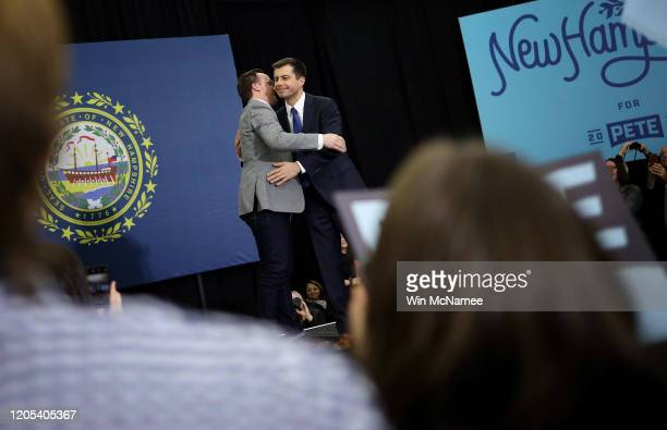 Democratic presidential candidate former South Bend Indiana Mayor Pete Buttigieg hugs his husband Chasten after speaking at a Get Out the Vote rally...