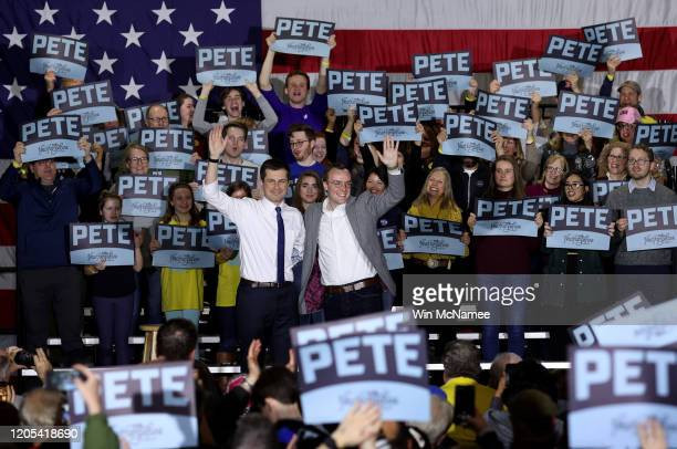 Democratic presidential candidate former South Bend Indiana Mayor Pete Buttigieg and his husband Chasten wave to the audience after the candidate...