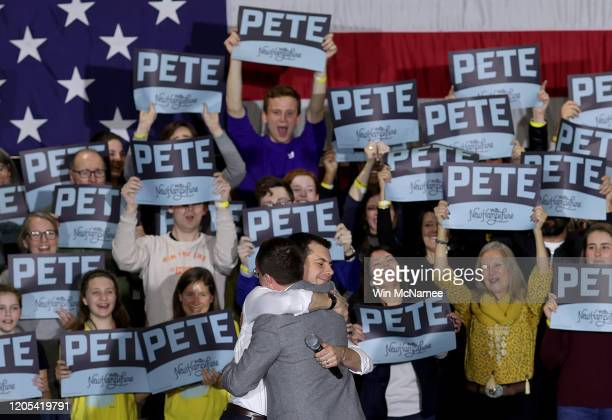 Democratic presidential candidate former South Bend Indiana Mayor Pete Buttigieg hugs his husband Chasten after the candidate spoke at a Get Out the...