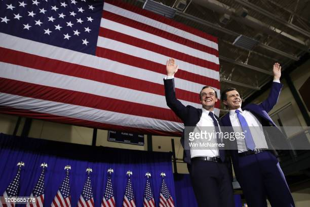 Democratic presidential candidate former South Bend Indiana Mayor Pete Buttigieg appears on stage with his husband Chasten Buttigieg at his primary...