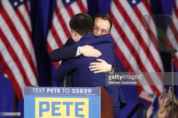Democratic presidential candidate former South Bend Indiana Mayor Pete Buttigieg hugs his husband Chasten Buttigieg at his primary night watch party...