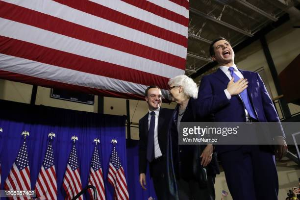 Democratic presidential candidate former South Bend Indiana Mayor Pete Buttigieg waves to the crowd with his mother Jennifer Anne Montgomery and...