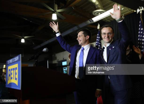 Democratic presidential candidate former South Bend, Indiana Mayor Pete Buttigieg and his husband Chasten wave to supporters after the candidate...