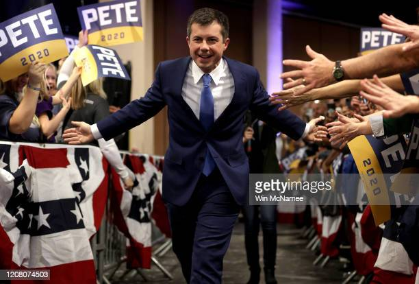 Democratic presidential candidate former South Bend Indiana Mayor Pete Buttigieg greets supporters as he arrives at a town hall campaign event at the...
