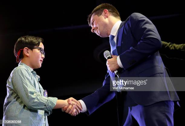Democratic presidential candidate former South Bend, Indiana Mayor Pete Buttigieg greets Zachary Ro, who asked Buttigieg to help him tell others he...