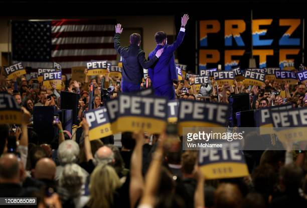 Democratic presidential candidate former South Bend Indiana Mayor Pete Buttigieg and his husband Chasten wave to supporters after the candidate spoke...