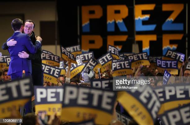 Democratic presidential candidate former South Bend Indiana Mayor Pete Buttigieg and his husband Chasten hug each other after the candidate spoke at...