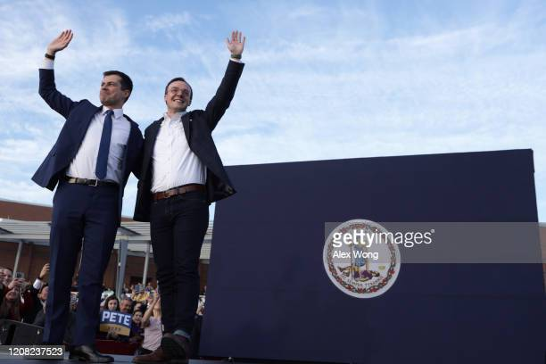 Democratic presidential candidate former South Bend Indiana Mayor Pete Buttigieg and his husband Chasten Buttigieg wave during a campaign town hall...