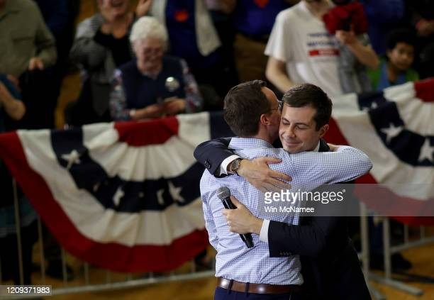 Democratic presidential candidate former South Bend, Indiana Mayor Pete Buttigieg hugs his husband Chasten after speaking at a town hall campaign...